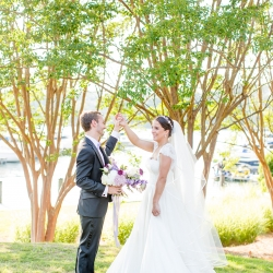 Bride and groom share a moment during their summer wedding coordinated by Magnificent Moments Weddings at The Peninsula Yacht Club