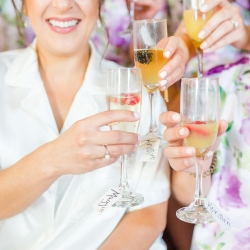 Bride and her bridesmaids wear matching pajamas and enjoy cocktails as they get stunning hair and make up by Cali Stott Artistry