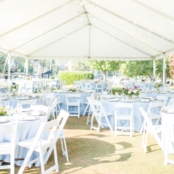 A Lake wedding at the Peninsula Yacht Club featured a white tent and soft blue linens from Party Reflections