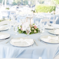 Soft blue linens and pastel floral centerpieces created a light and airy feel for a summer wedding at The Peninsula Yacht Club coordinated by Magnificent Moments Weddings