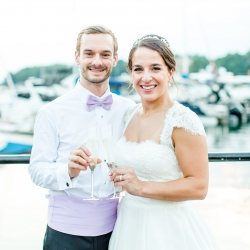 Bride and groom share a toast to their marriage on the docks of The Peninsula Yacht Club