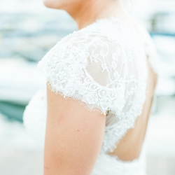 More Beatty Photography captures the stunning lace details on a brides dress for her summer wedding at The Peninsula Yacht Club