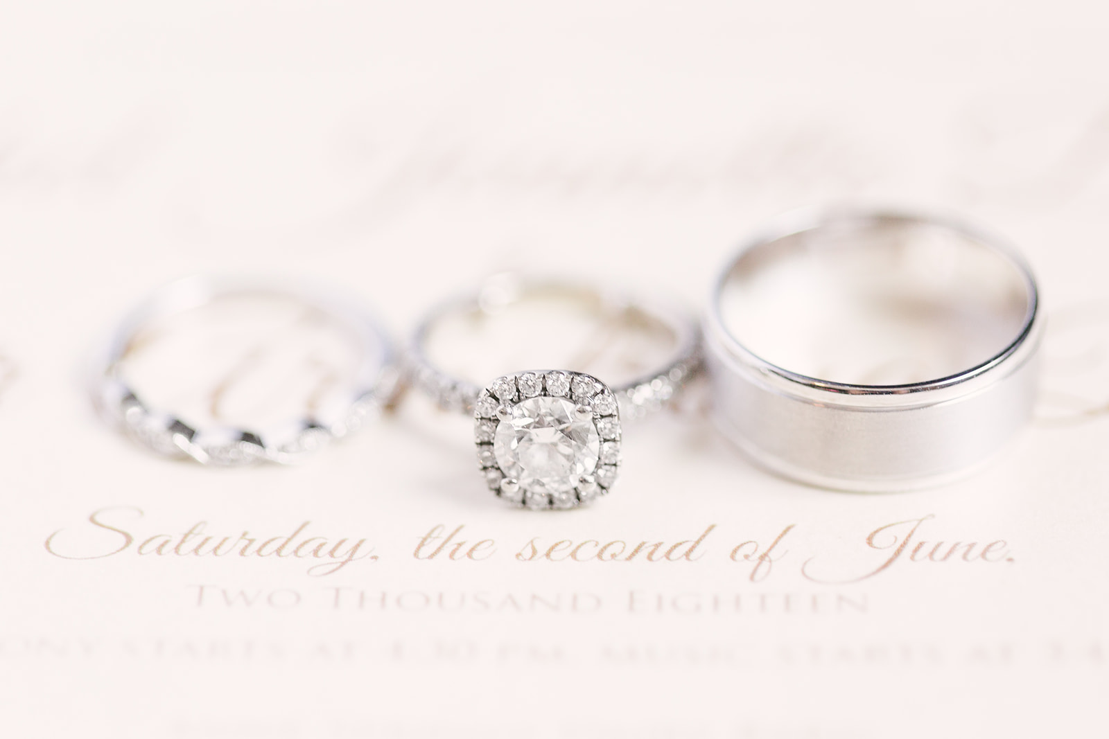 Detail shot of bridal rings captured by Paige Ryan Photography for a spring wedding at The Diary Barn
