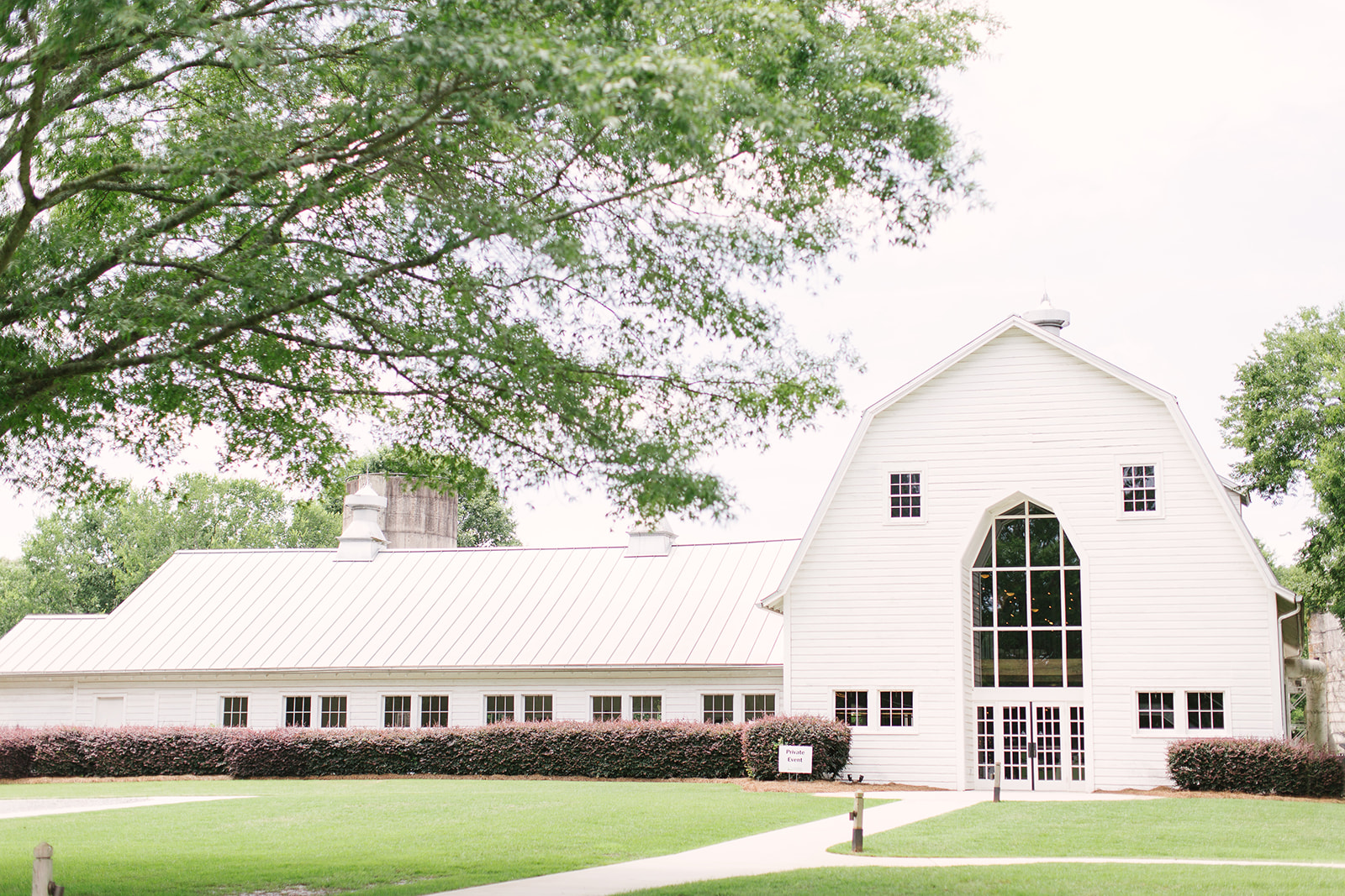 The Diary Barn in Fort Mill South Carolina serves as the perfect setting for a spring wedding captured by Paige Ryan Photography and coordinated by Magnificent Moments Weddings