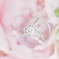 Detail shot of bridal rings in pale pink bridal bouquet by Charlotte Flower Market for a spring wedding at The Diary Barn