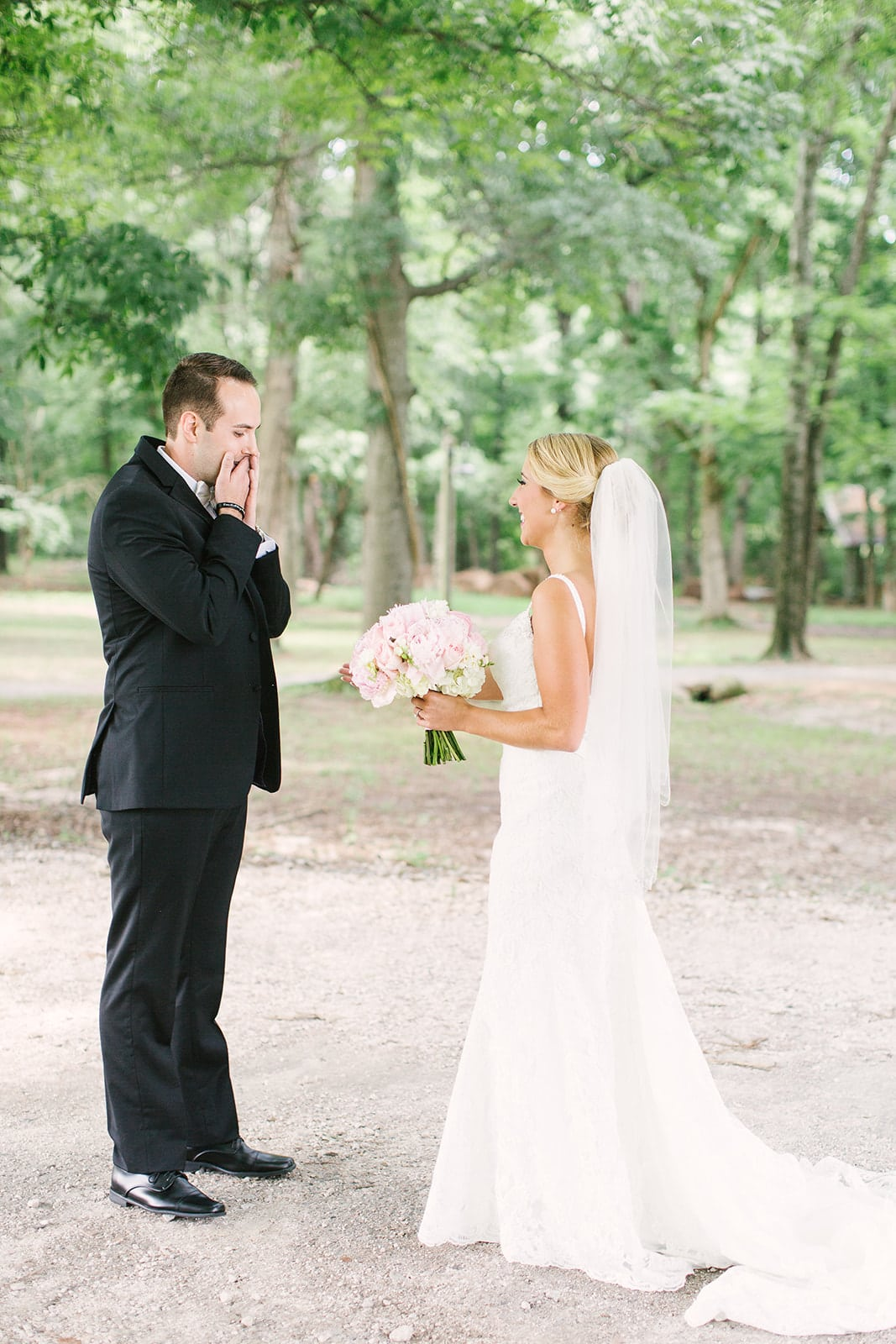 Groom shows off a surprised look as he sees his bride for the first time before their spring wedding at The Diary Barn in Fort Mill. South Carolina