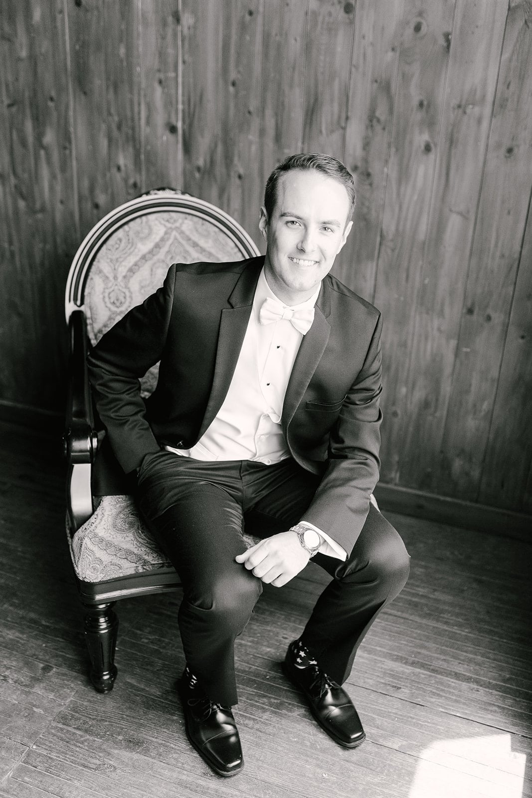 Groom poses before his spring wedding at The Diary Barn which was coordinated by Magnificent Moments Weddings