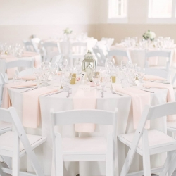 Reception at the Dairy Barn with crisp white linens accented by pale pink napkins captured by Paige Ryan Photography