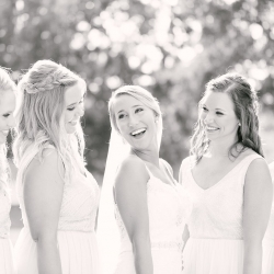 Bride poses with her bridesmaids before her ceremony at The Diary Barn coordinated by Magnificent Moments Weddings