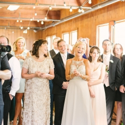 Family share a fun moment to music provided by Soto's DJ at a spring reception at The Diary Barn captured by Paige Ryan Photography