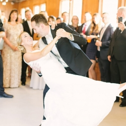 Bride and groom share a first dance to music provided by Soto's DJ at their spring reception at The Diary Barn coordinated by Magnificent Moments Weddings