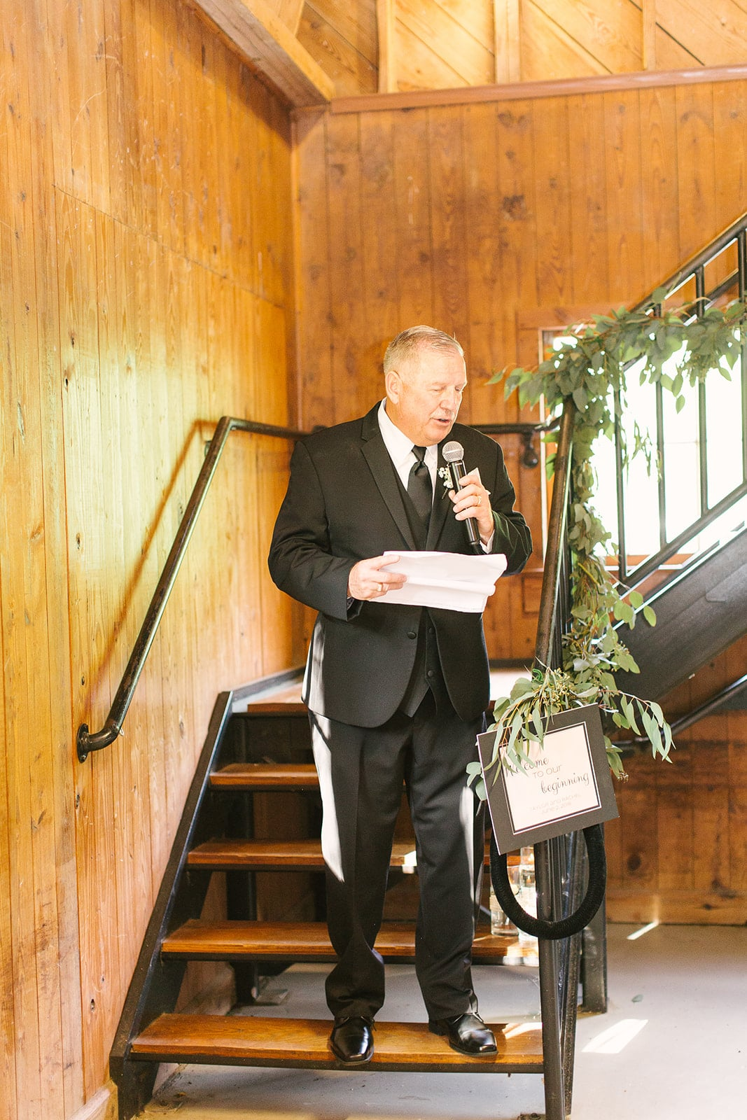 Father of the Bride gives a toast at a spring wedding reception at the Diary Barn coordinated by Magnificent Moments Weddings