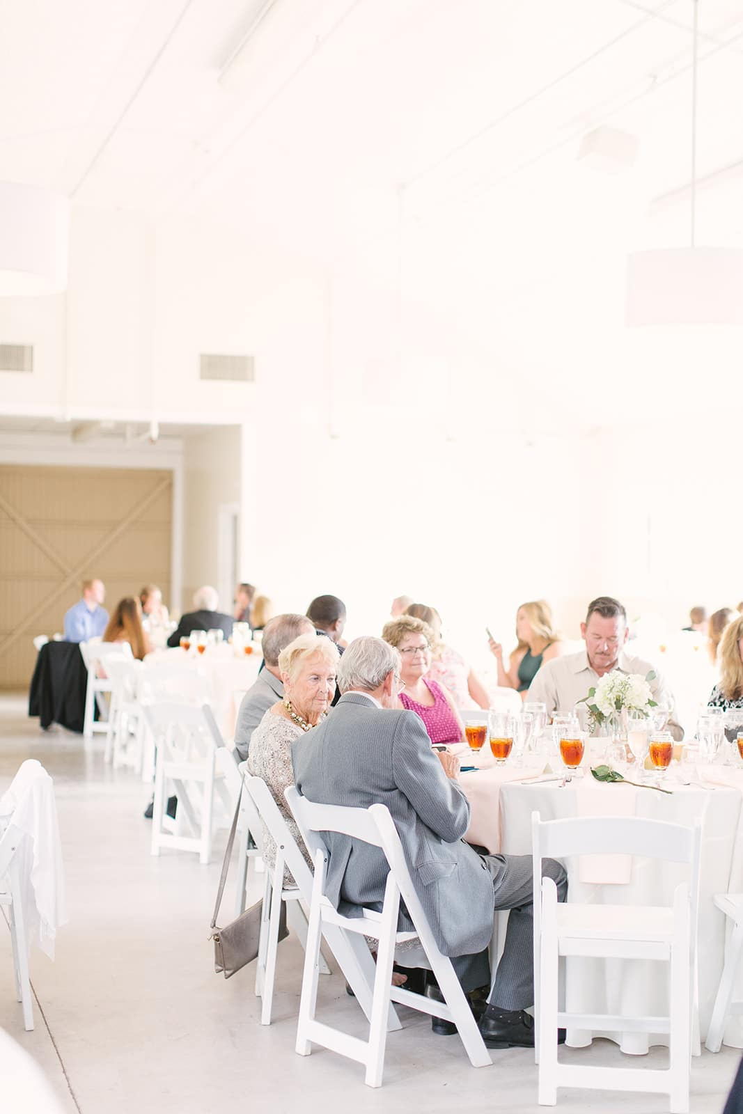 Beautiful spring reception at the Diary Barn coordinated by Magnificent Moments Weddings and captured by Paige Ryan Photography