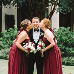 Groom with bridesmaids in maroon dresses