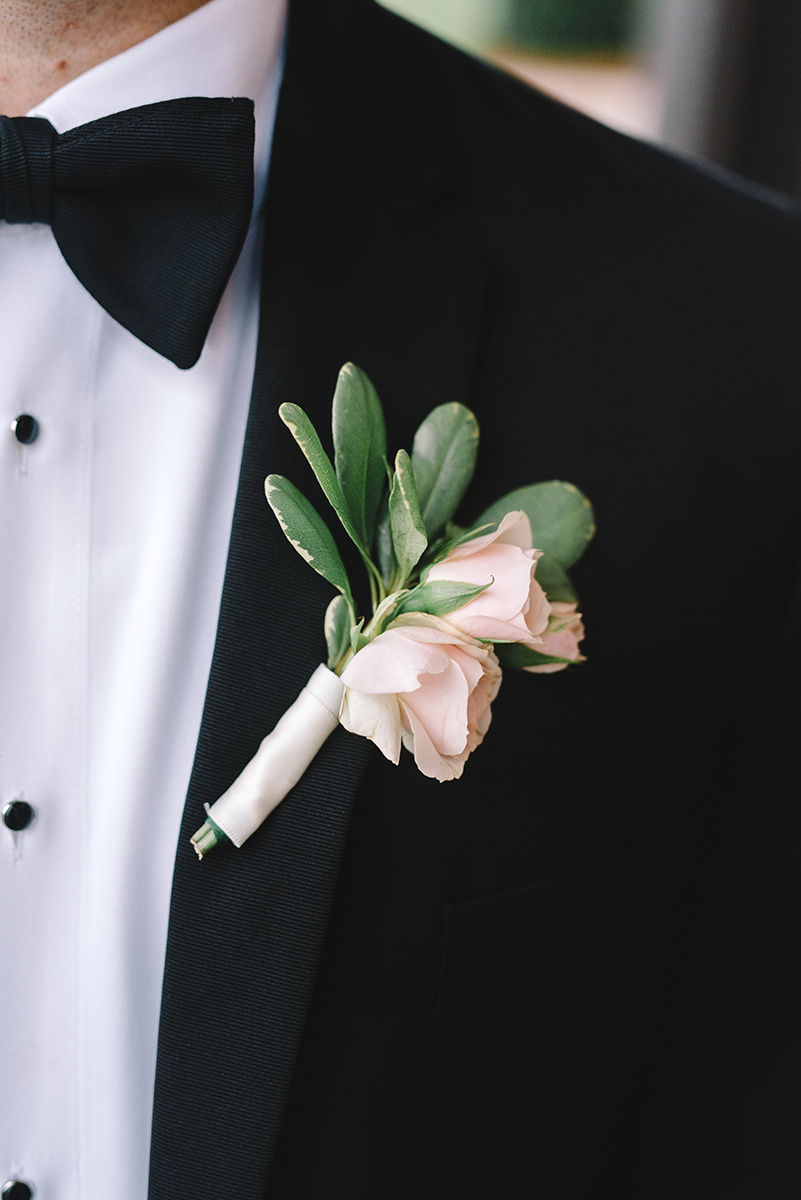 Groom boutineer greenery with roses by Magnificent Moments Weddings