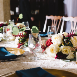 Romantic wedding, gold chargers, navy napkins and maroon accents