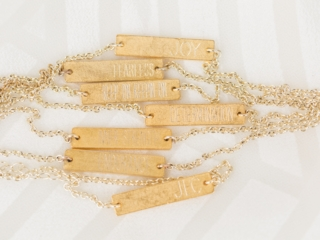 Bridesmaids gifts of custom stamped gold bracelets featuring the names of each bridesmaid for a Charlotte North Carolina Wedding
