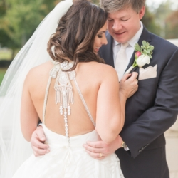 Bride and groom embrace for a Charlotte Wedding at Dilworth United Methodist Chruch captured by Ryan and Alyssa Photography and coordinated by Magnificent Moments Weddings