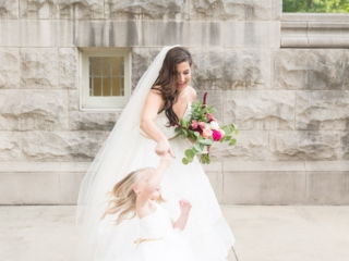 Bride with spinning flower girl captured by Ryan and Alyssa Photography for a Charlotte North Carolina wedding
