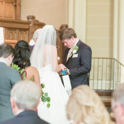 Wedding ceremony at Dilworth United Methodist Church bride and groom embracing during vows captured by Ryan and Alyssa Photography