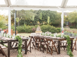 Outdoor wedding reception under clear top tent with dark wood farmhouse tables and chairs rented from Party Reflections coordination done by Magnificent Moments Weddings
