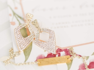 Detail shot of bridal jewelry captured by Ryan and Alyssa Photography