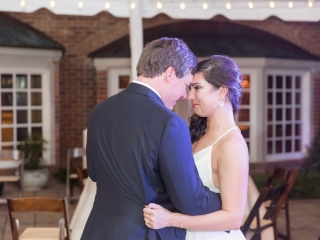 Wedding reception first dance bride and groom embrace at a Carmel Country Club to music provided by Bantum Rooster from East Coast Entertainment
