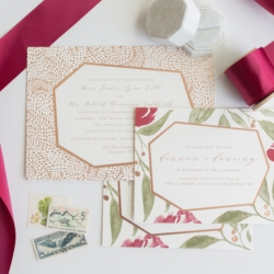 Wedding invitation suite with gold accents and floral design show off wine and greenery colors accompanied in the Charlotte outdoor reception