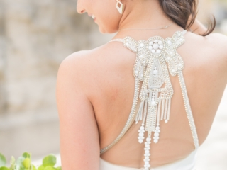 Detail of bridal gown back with jeweled straps shows off bridal hair created by Julie Jackson