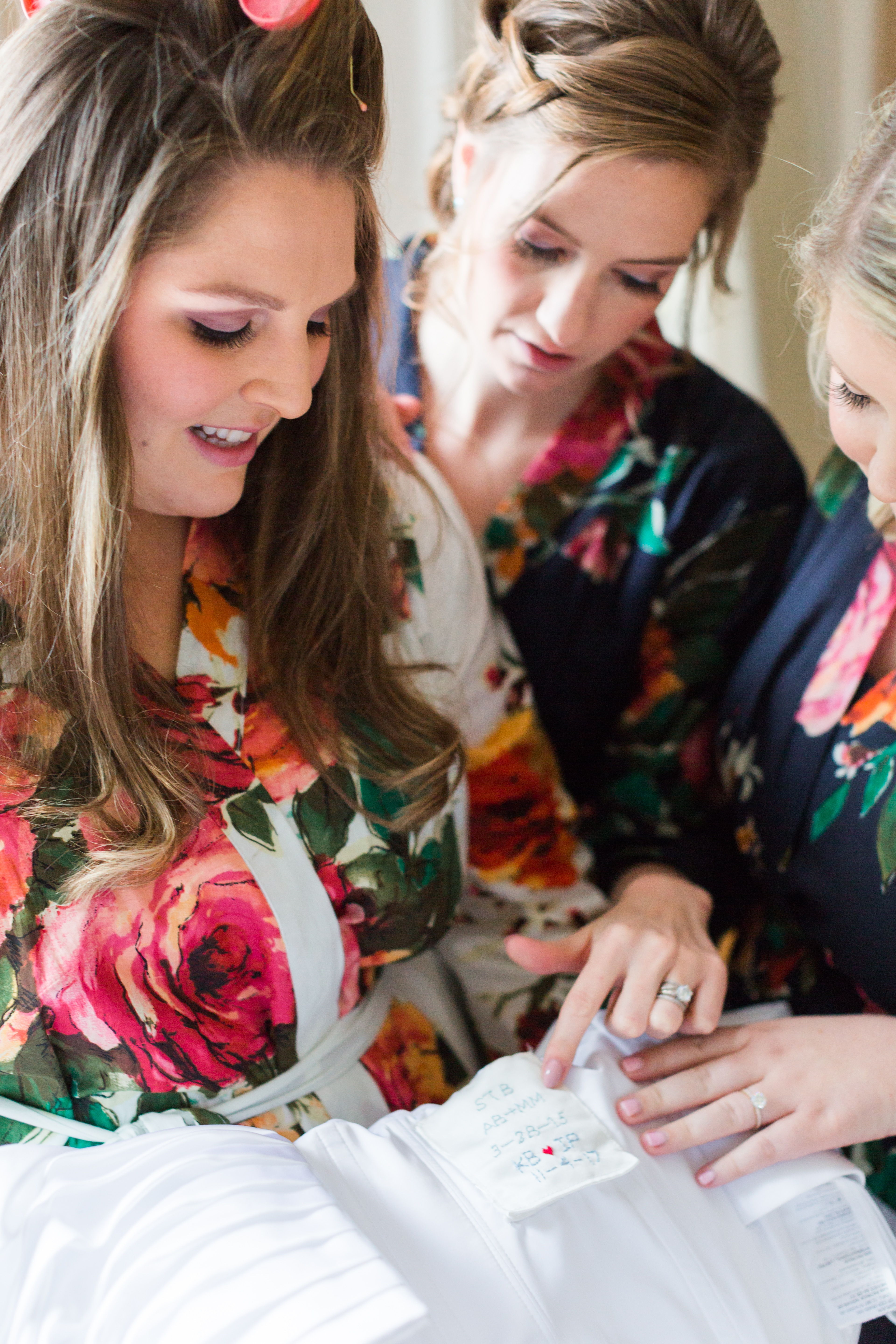 Bridal party getting ready picture matching floral silk robes for a Peninsula Yacht Club wedding