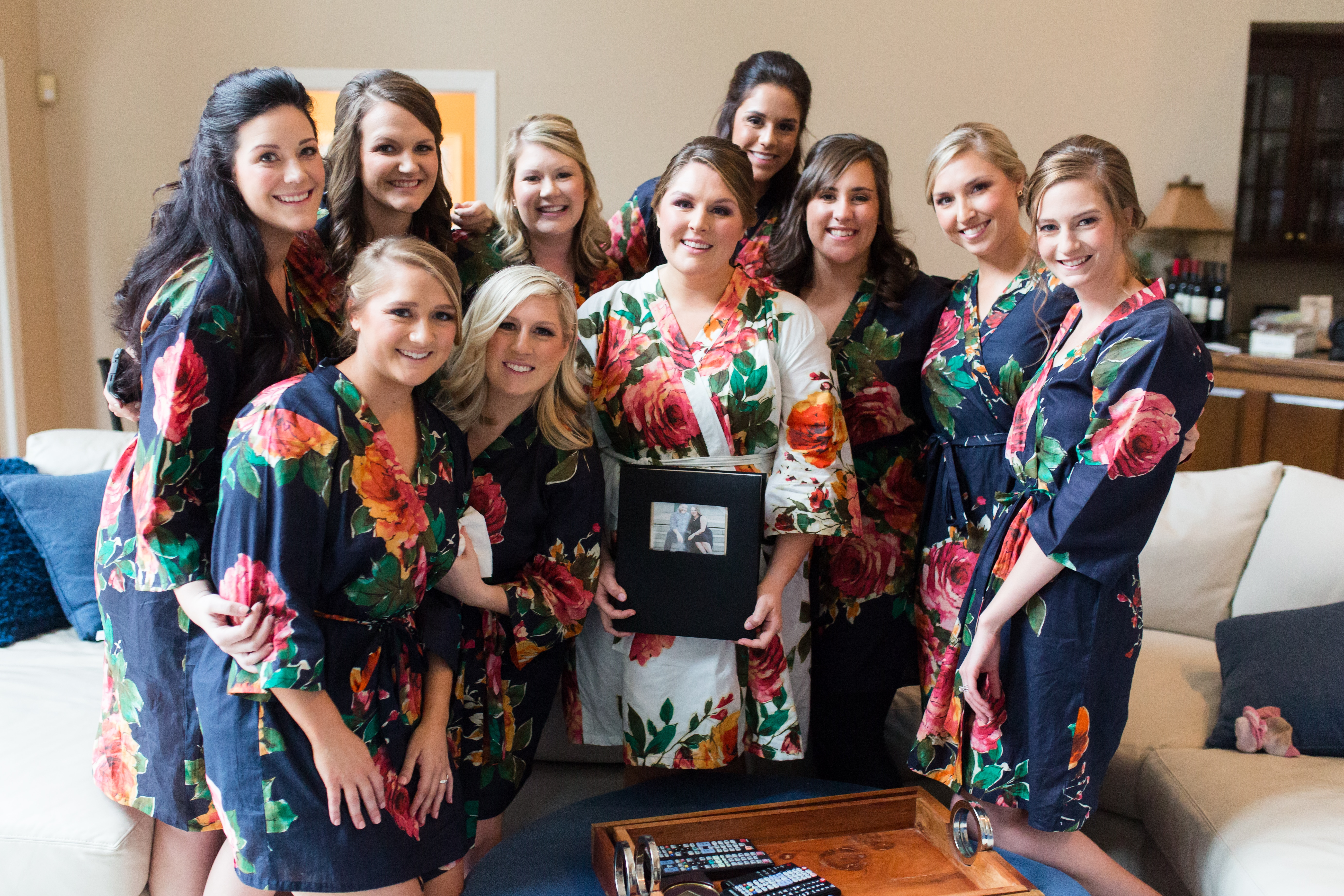 Bridal getting ready pictures in matching floral silk robes, hair and makeup by Charisse with Be Pretty