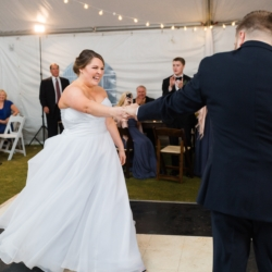 Bride and groom first dance, black and white dance floor, Edison light decor, coordination by Magnificent Moments Weddings