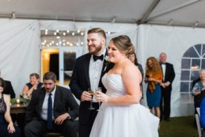 Bride and groom toast at Peninsula Yacht Club wedding reception coordinated by Magnificent Moments Weddings