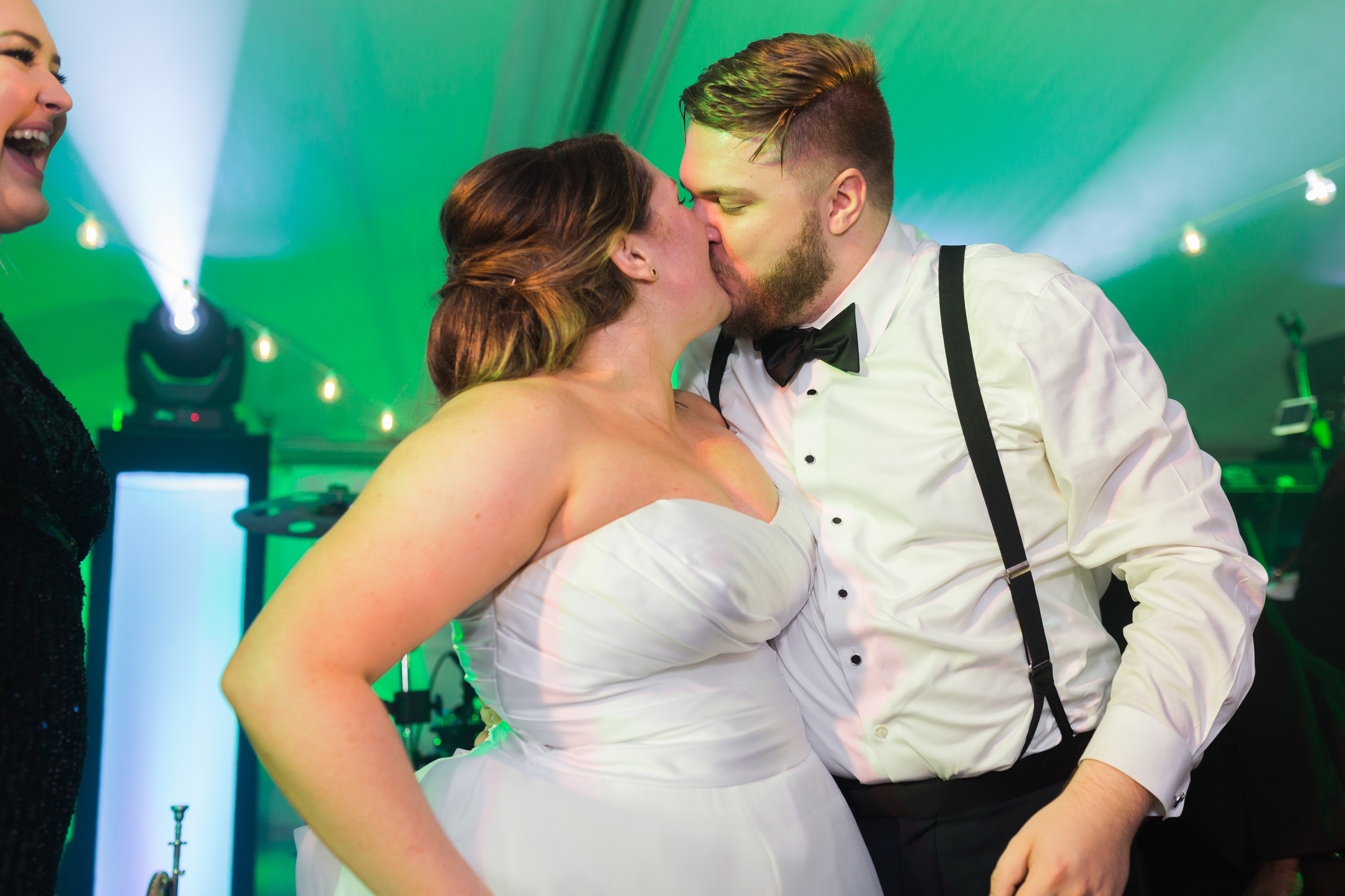 Wedding reception embrace between bride and groom party music provided by Punch by East Coast Entertainment