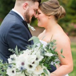 Bride and groom embracing at a Peninsula Yacht Club wedding outdoor portraits