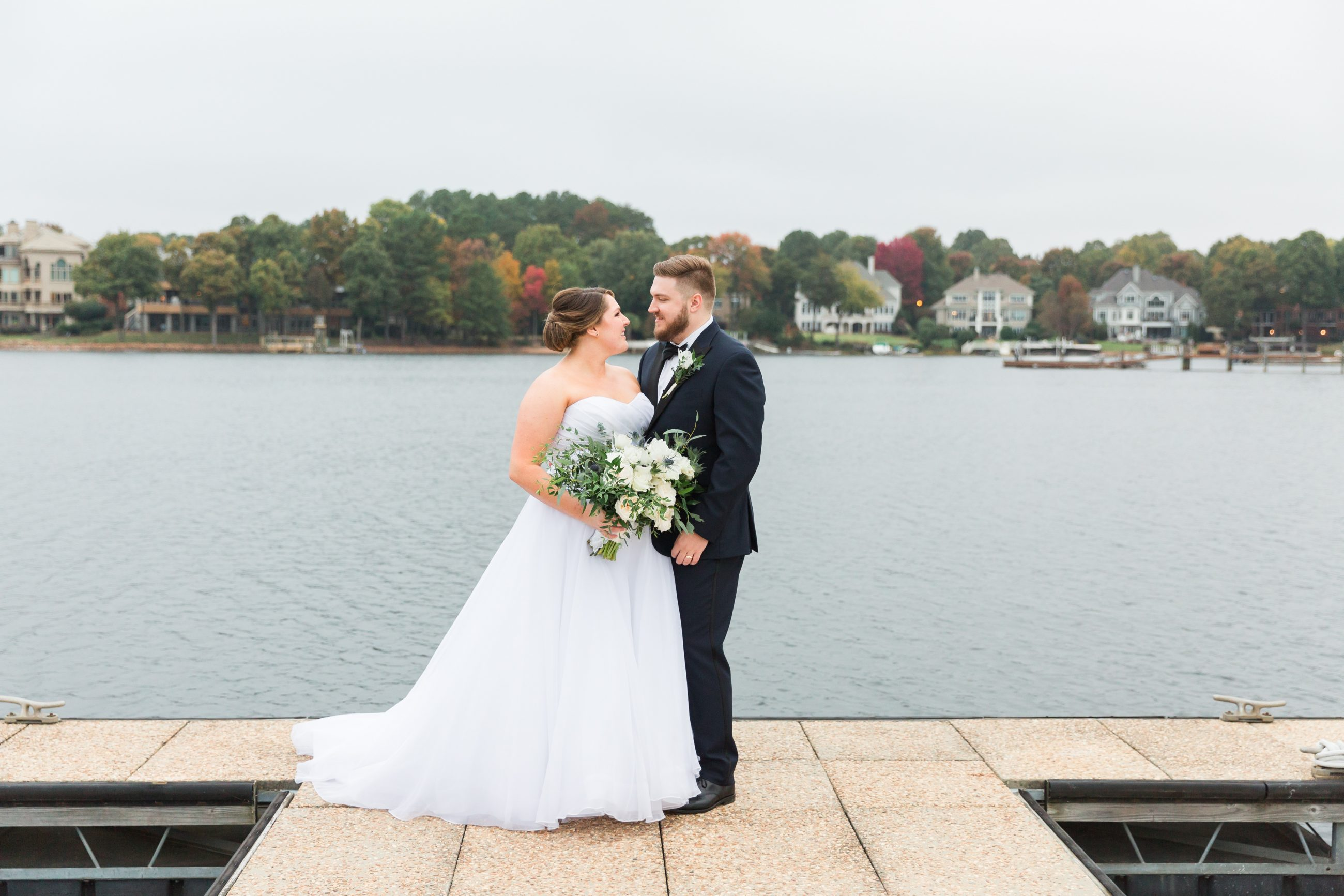 Peninsula Yacht Club wedding dock picture of bride and groom flowers by Magnificent Moments Weddings