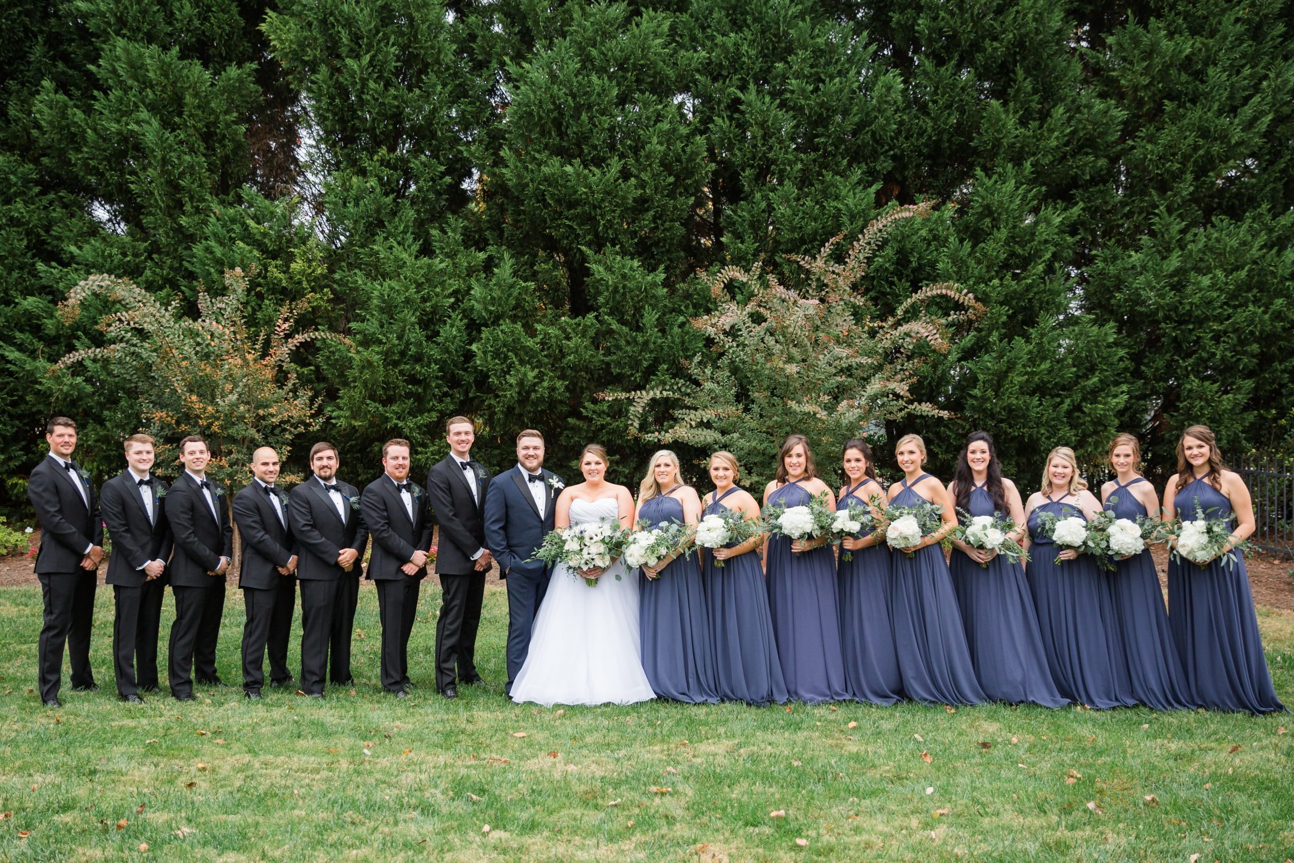 Bridal Party with bridesmaids in dusty blue bridesmaids dresses outside pictured captured by Samantha Laffoon Photogrpahy