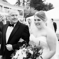 Bride walking down the aisle with father for an outside ceremony at Peninsula Yacht Club coordinated by Magnificent Moments Weddings