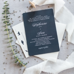 Wedding invitation dark blue accented with cream lettering from Minted