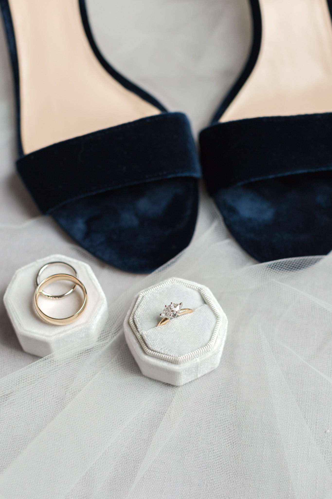 Bridal ring detail shot with navy blue velvet shoes captured by Samantha Laffoon Photography