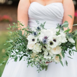 Hand tied bridal bouquet with white roses by Magnificent Moments Weddings design