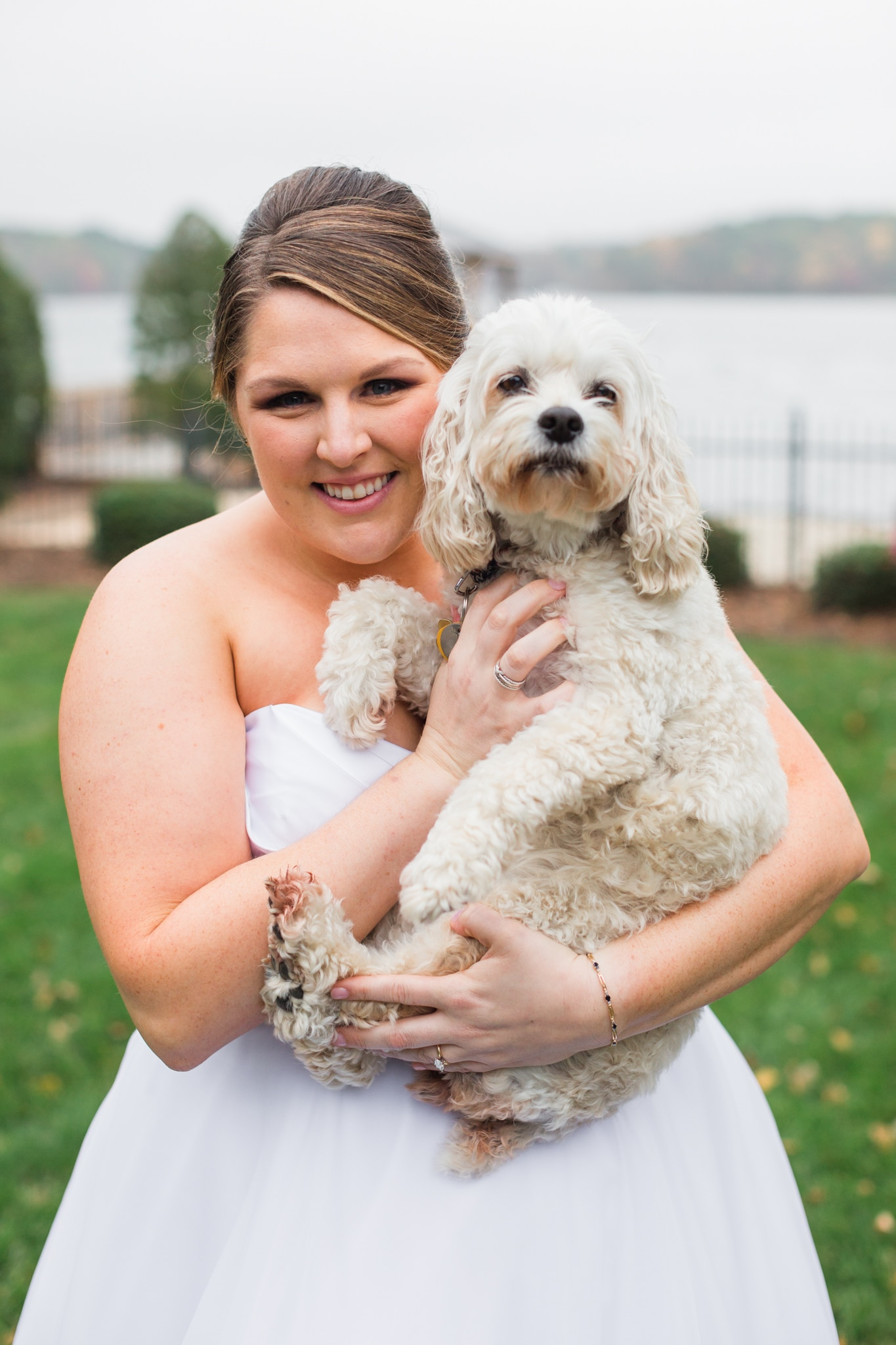 Bride poses with dog at a Peninsula Yacht Club wedding captured by Samantha Laffoon Photography