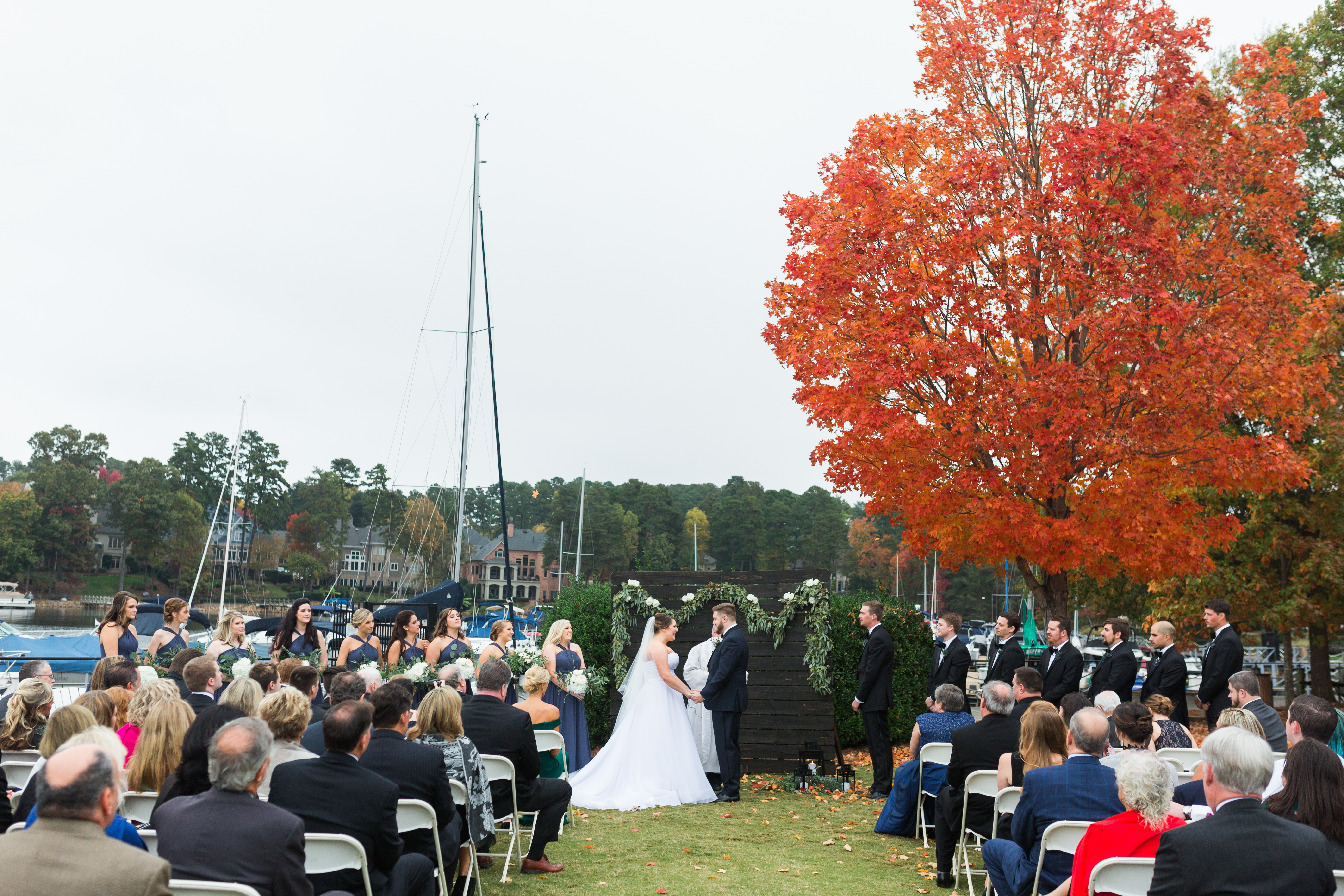 Outdoor fall ceremony captured by Samantha Laffoon Photography at the Peninsula Yacht Club