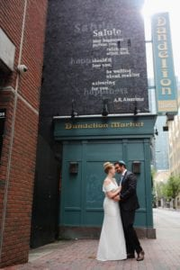 Bride and groom embrace for photo after Uptown Charlotte Wedding coordinated by Magnificent Moments Weddings