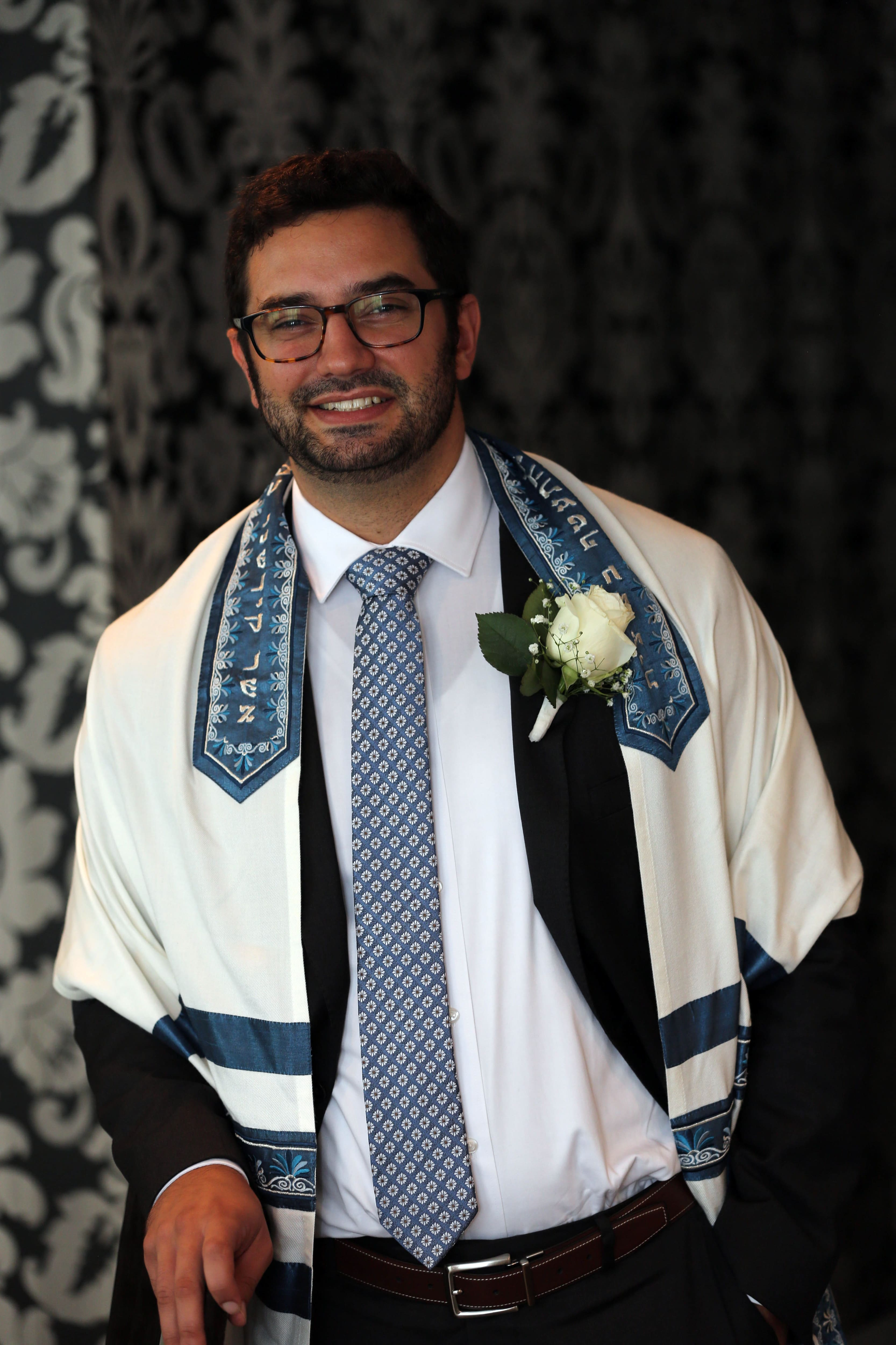 Image of groom posing prior to his Jewish wedding ceremony in Uptown Charlotte North Carolina
