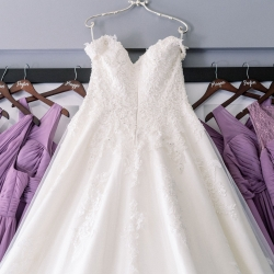 Sunshower Photography captures a brides gown with her bridesmaids dresses lined up and ready to go for her wedding coordinated by Magnificent Moments Weddings
