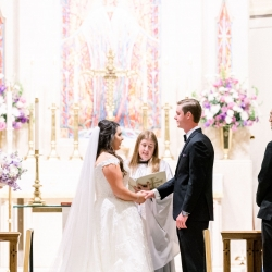 Bride and groom exchange vows during their spring wedding ceremony captured by Sunshower Photography