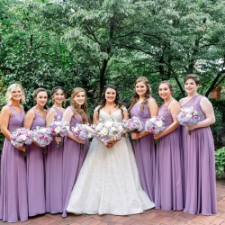 Bride poses with her bridesmaids they prepare for her spring wedding day at Foundation for the Carolinas