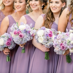 Stunning bouquets by CLux include white hydrangeas and soft touches of lavender flowers all for a spring wedding at Foundation for the Carolinas