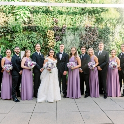 Bride and groom pose with their bridal party before their spring wedding at Foundation for the Carolinas